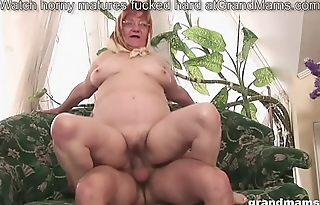 Elderly hairy granny is thirsty for a young cock
