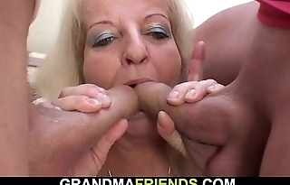 Blonde 70 yo woman rides and sucks at same time