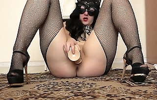 Sexy brunette with a juicy jam-packed with seductive pantyhose masturbates with a dildo.