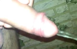 Young semi hard cock pissing