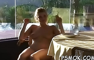 Elegant playgirl in sexy lingerie likes to tease while smoking
