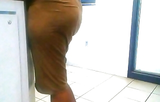 Booty in a short skirt at the post office