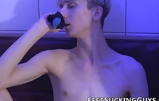 Toe licking twink strokes his constant cock in the locker room