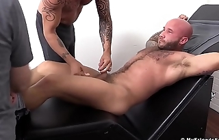 Tattooed stumbling-block on the bondage machine tickled by two fellas