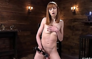 Shrivelled redhead fucks machine in shoes